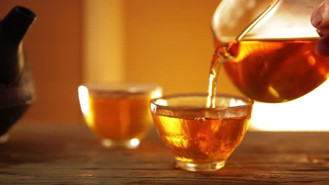 asia traditional health drinking,tea pouring into a tea cup - teapot stock videos & royalty-free footage