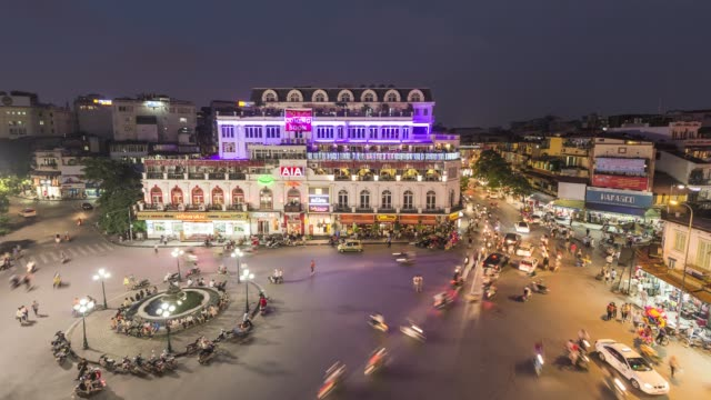 asia, vietnam, hanoi, elevated view of city centre and bust road junction at dusk - hanoi stock videos and b-roll footage