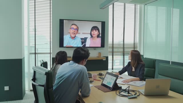 asia white collar worker having video conference videocall with company staff meeting discussion in the conference room board of directors have video call with foreign investor. business meeting with mergers and acquisitions - liquid crystal display stock videos & royalty-free footage