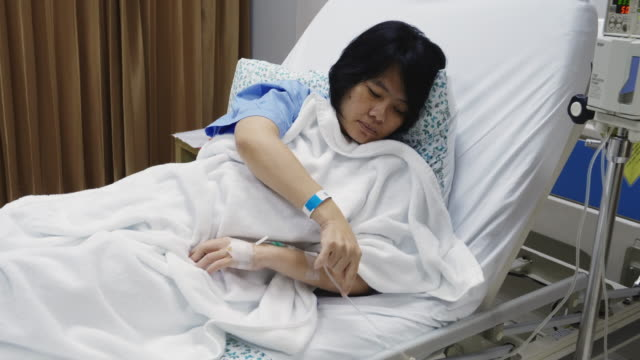asia woman a cough and sick with mask on patient bed. - recovery stock videos & royalty-free footage