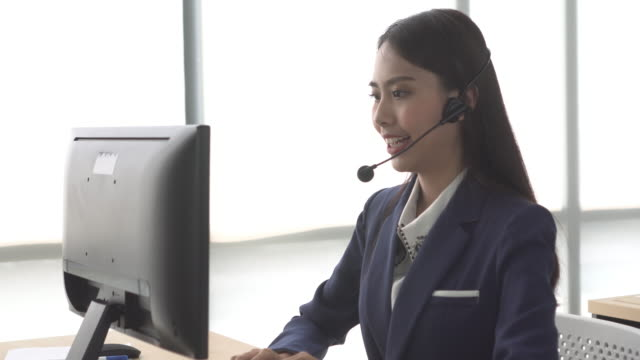 asia woman call center talk to customer with windows light - salesman stock videos & royalty-free footage