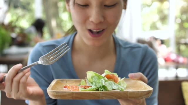 asia woman eating salad - meal stock videos & royalty-free footage