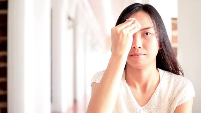 HD: Asia woman facial tissue.