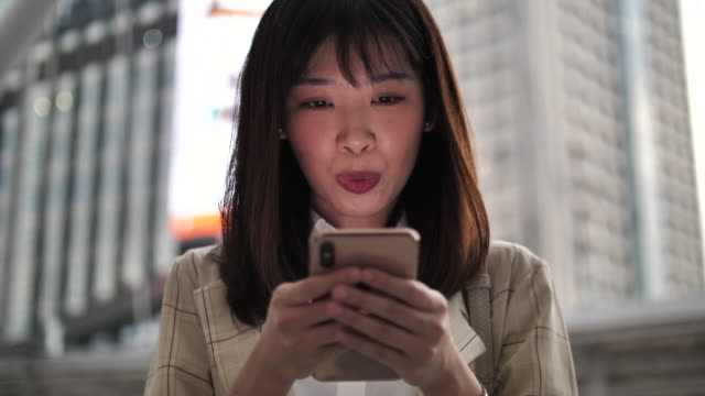 asia woman using smart phone - south east asia stock videos & royalty-free footage