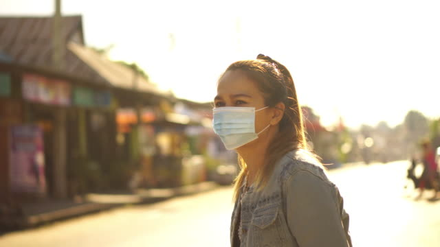 asia woman wearing a dust mask, pm 2.5 and antivirus covid-19 - pedestrian stock videos & royalty-free footage
