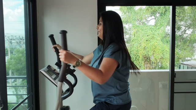 asia woman working out and jogging on treadmill at house - cross trainer stock videos & royalty-free footage