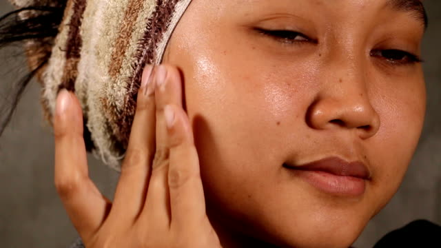 asia woman's hand applying cream. - face cream stock videos and b-roll footage