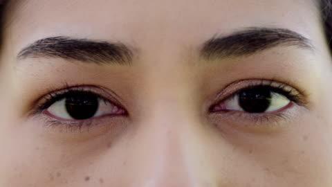 asia women open eye.eyes close up - blinking stock videos & royalty-free footage