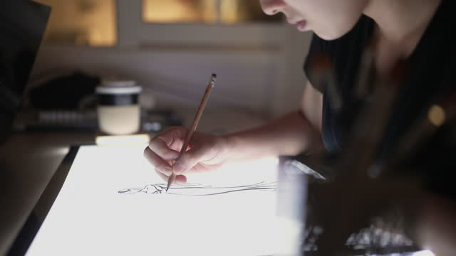 asian artist drawing sketch on draft board at home - drawing art product stock videos & royalty-free footage