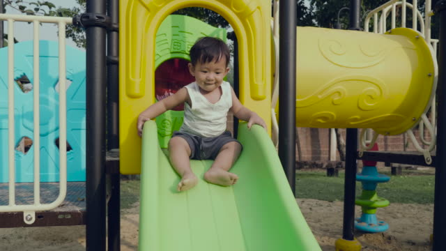 asian baby boy at the playground - sliding stock videos & royalty-free footage