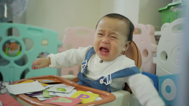 asian baby boy crying unhappy feeling. - one baby boy only stock videos & royalty-free footage