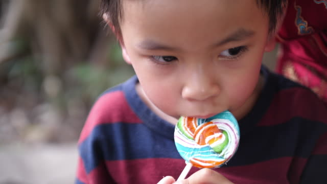 asian baby boy eating candy - lollipop stock videos & royalty-free footage