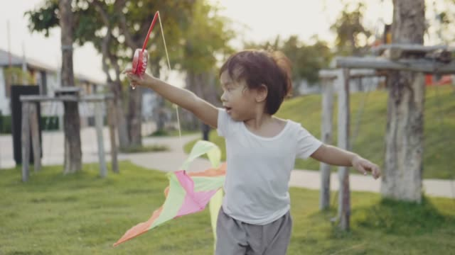 asian baby boy flying a kite. happy memories of his young days - kid with kite stock videos & royalty-free footage