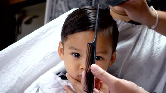 asian baby boy hair cutting. - cutting hair stock videos and b-roll footage