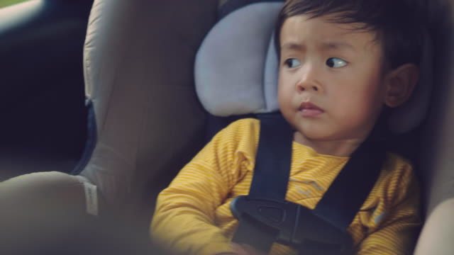 asian baby boy in his child safety car seat - - car interior stock videos & royalty-free footage