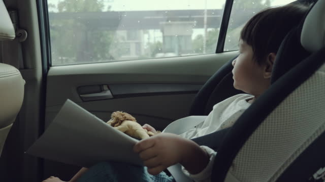 asian baby boy in his child safety car seat - baby boys stock videos and b-roll footage