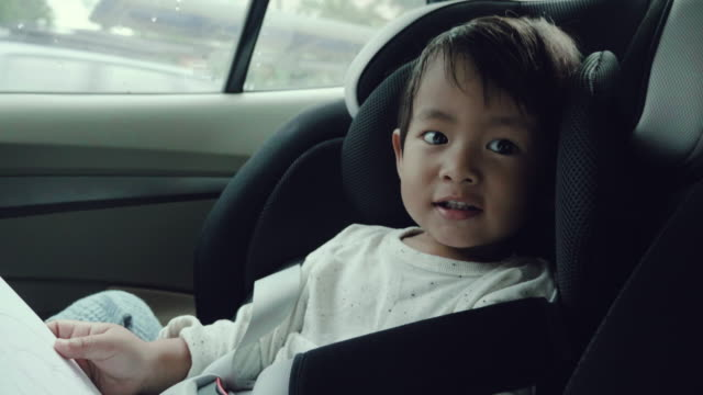 asian baby boy in his child safety car seat - back seat stock videos & royalty-free footage