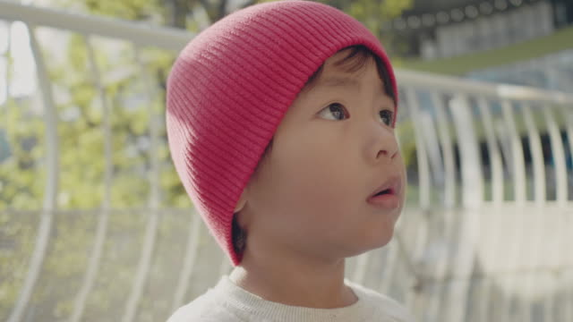 asian baby boy in the city portrait - woolly hat stock videos and b-roll footage