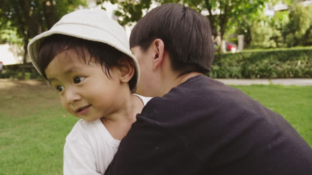 Asian baby boy Learning to run with asian lesbian in Park