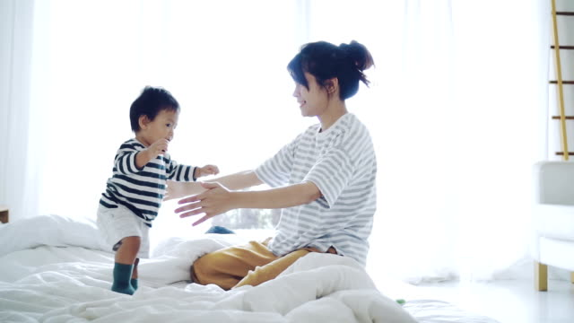 asian baby (6-11 months) boy learning to walk with mother. - oriental culture stock videos & royalty-free footage