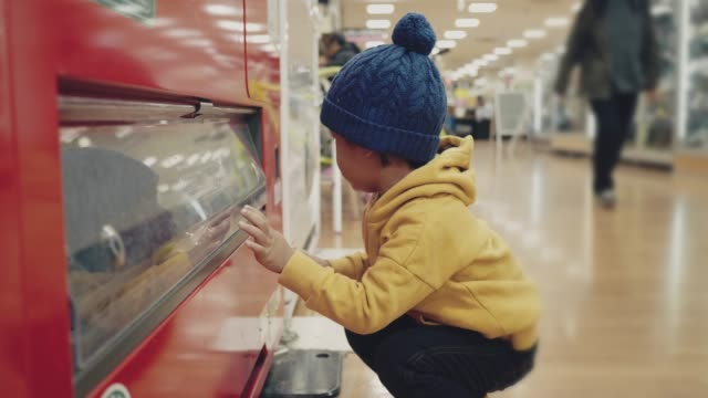 asian baby boy picking water bottle to vending machine. - convenience food stock videos and b-roll footage