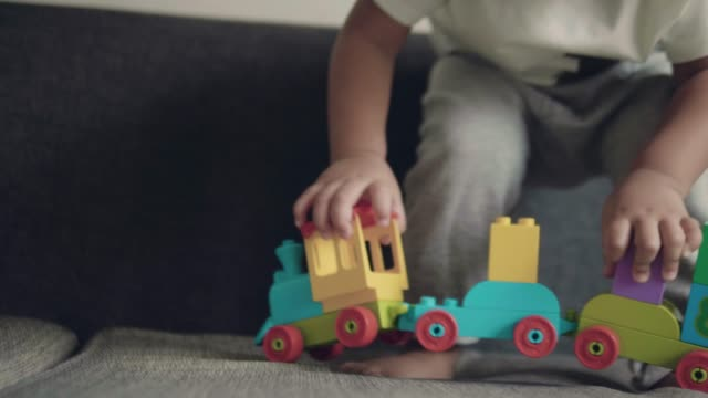 asian baby boy playing with toys. - one baby boy only stock videos & royalty-free footage