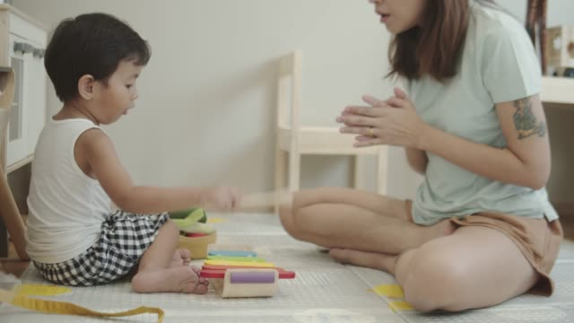 asian baby boy playing xylophone at home - maraca stock videos & royalty-free footage