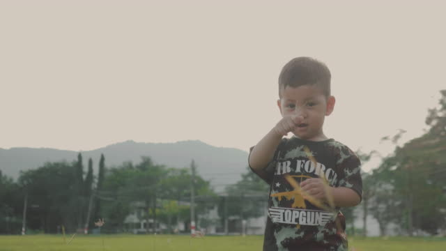asian baby boy running at the park during sunset. - military fitness stock videos and b-roll footage