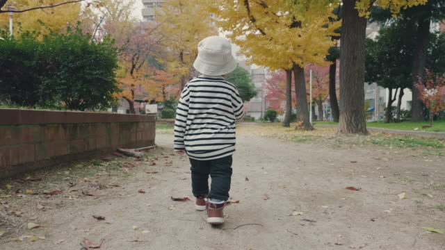 Asian baby boy running in the park
