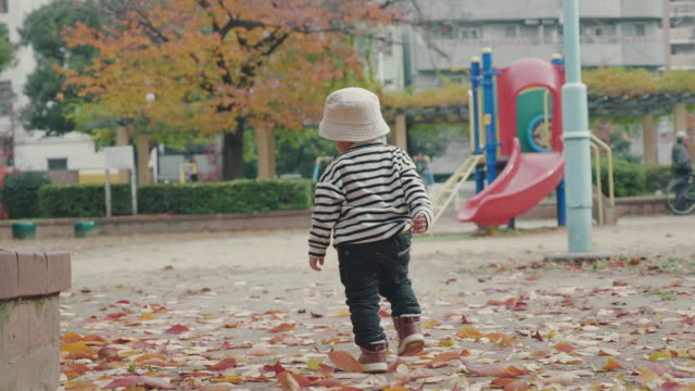 asian baby boy running in the park - babies only stock videos & royalty-free footage