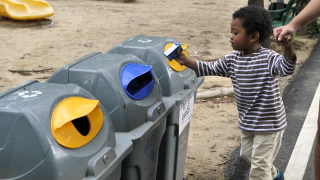 asian baby boy throwing out plastic bottle into recyclable bin - collection stock videos & royalty-free footage