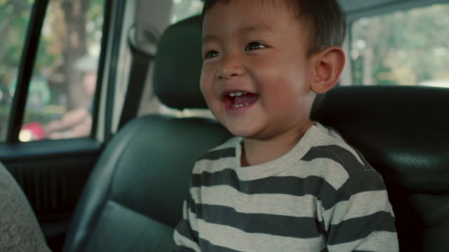 asian baby boy traveling in a family car - back seat stock videos and b-roll footage