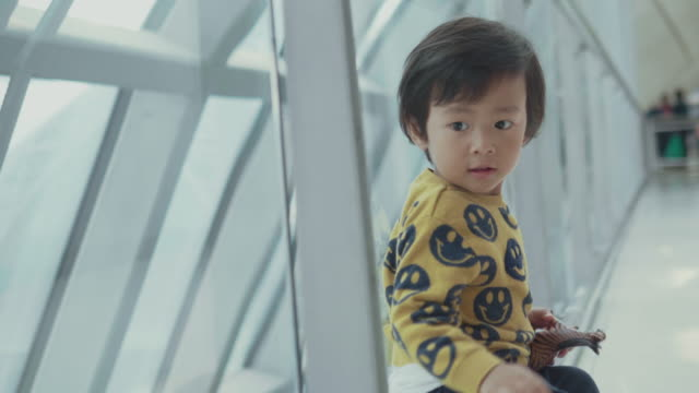 asian baby boy watching planes at the airport - arrival stock videos & royalty-free footage