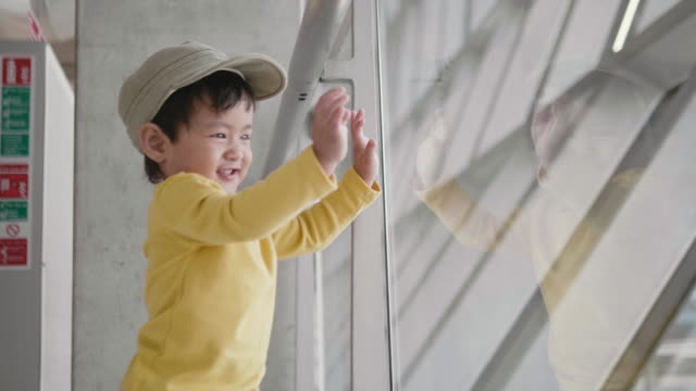 asian baby boy watching planes at the airport - separation stock videos & royalty-free footage