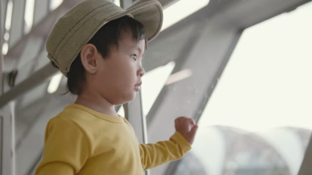 asian baby boy watching planes at the airport - one baby boy only stock videos & royalty-free footage