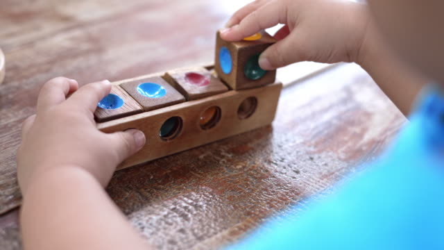 asian baby boys playing wood toys - toy block stock videos and b-roll footage