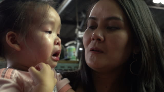 asian baby crying with mom. - candid stock videos & royalty-free footage