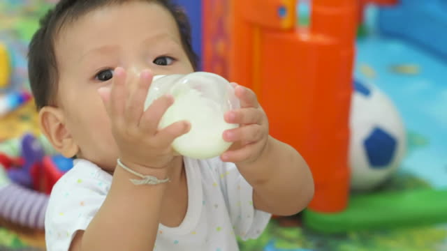 Asian baby drinking milk