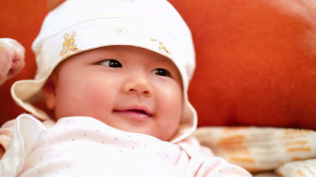 asian baby girl are so very cute - hugging self stock videos & royalty-free footage