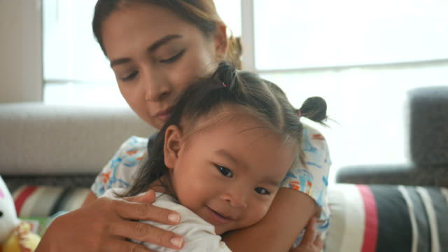 asian baby girl embracing with mother - preschool student stock videos and b-roll footage