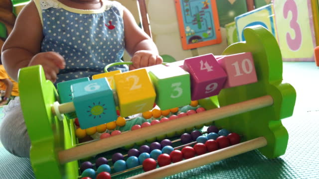 asian baby girl playing education toy box - the alphabet stock videos & royalty-free footage