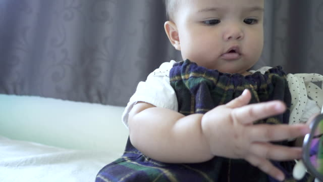 asian baby girl playing with sunglasses - uv protection stock videos and b-roll footage
