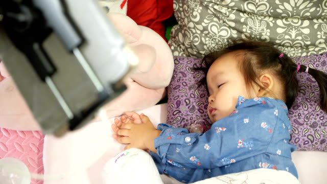 asian baby girl sleeping on the bed. - baby girls stock videos & royalty-free footage
