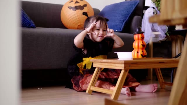 asian baby girl with pumpkin toy while eating and singing song with mother at home - one baby girl only stock videos & royalty-free footage