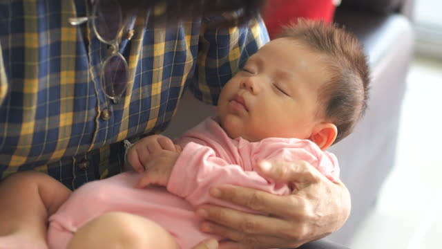 asian baby hold in arms - human limb stock videos & royalty-free footage
