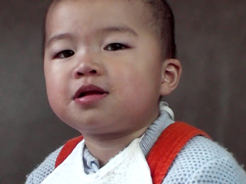 asian baby laughing to tears,food-in-mouth - last stock videos & royalty-free footage