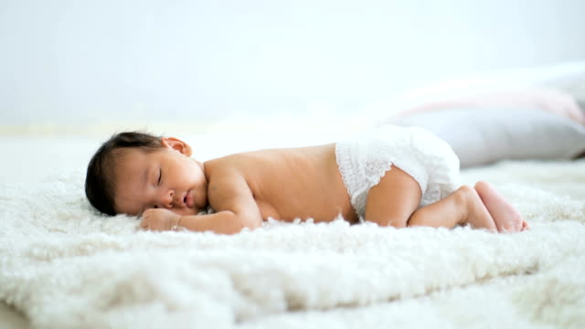 asian baby laying on a soft blanket - sleeping stock videos & royalty-free footage