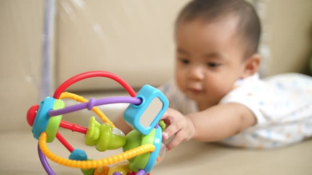 asian baby playing with toy at home - toy block stock videos and b-roll footage