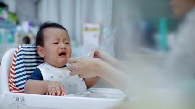 asian baby refused to eat (6-11 months) at dining table - refusing stock videos & royalty-free footage