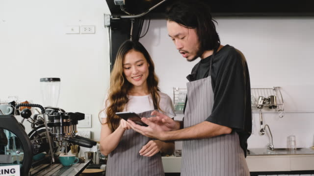asian barista waiter check inventory with tablet at counter bar,food and drink business concept,small business concept.restaurant worker - examining stock videos & royalty-free footage
